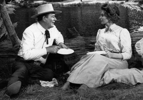 John Wayne and Capucine