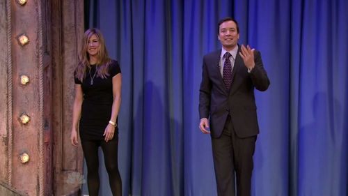 Jennifer Aniston achtergrond with a business suit, a suit, and a well dressed person called Late Night with Jimmy Fallon - May 4th 2009