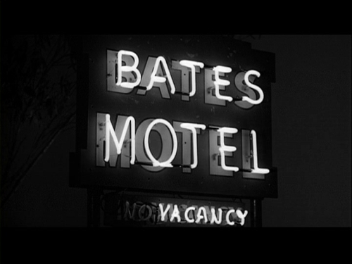 Psycho wallpaper possibly containing a package store, a tobacco shop, and a multiplex entitled Ominous Bates Motel Sign
