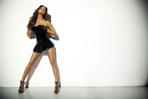 Eva Longoria wallpaper probably containing hosiery, a hip boot, and tights titled Eva