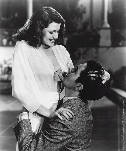 Classic Movies wallpaper probably containing a street, a bouquet, and a sign titled Rita Hayworth and Tyrone Power