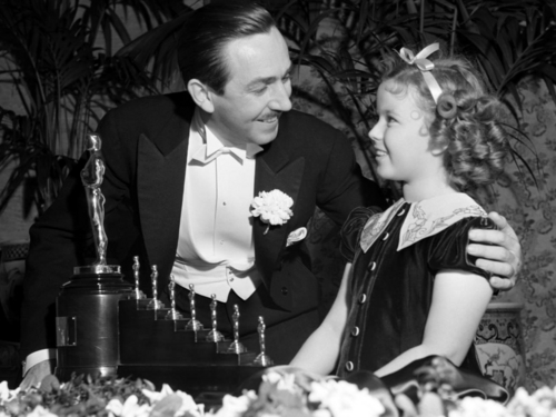 Walt Disney Getting Oscar for Snow White and the Seven Dwarfs