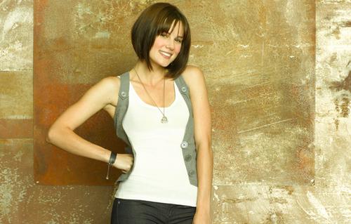 Chelsea Hobbs as Emily Kmetko