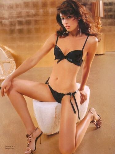 Olga Kurylenko achtergrond containing a bikini titled Olga