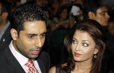 Aishwarya Rai kertas dinding containing a business suit and a portrait titled aishwarya and abhishek -iifa 2009