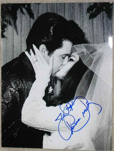 Elvis And Prescilla On Their Wedding Day