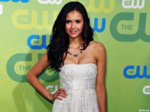 Nina Dobrev wallpaper probably containing a dinner dress, a gown, and a cocktail dress entitled Nina