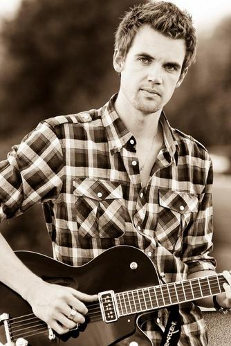Tyler Hilton wallpaper with a guitarist called Tyler Hilton