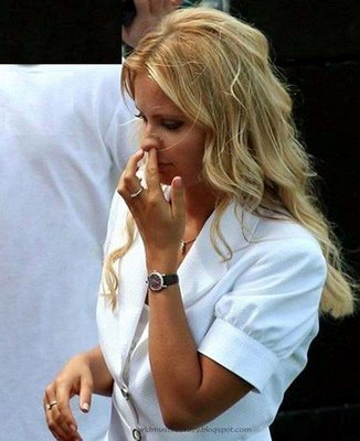 Jessica Simpson picking her nose
