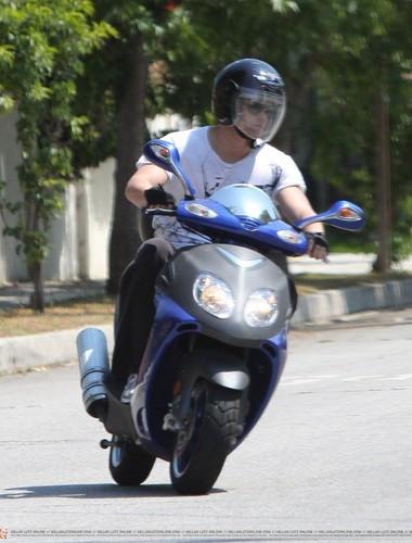 Kellan walking with his dog and riding his motorcycle