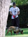 Kellan walking with his dog and riding his motorcycle - twilight-series photo