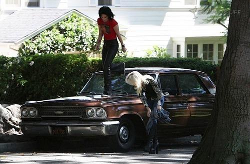 Kristen and Dakota on set of The Runaways