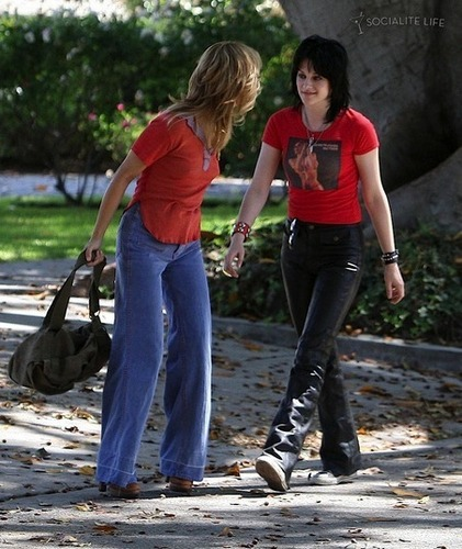 Kristen and Dakota on set of The Runaways