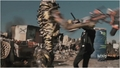 District 9 D9 alien attacking swinging melee weapon - district-9 screencap