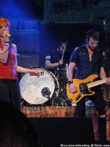 Brand New Eyes wallpaper possibly with a guitarist, a drummer, and a concert entitled Paramore! (On tour)