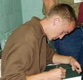 Tom Felton signing autographs