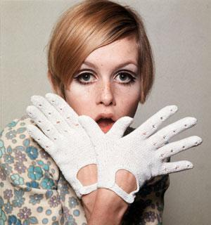 The 60's wallpaper probably with an outerwear, a handwear, and a blouse called Twiggy the model