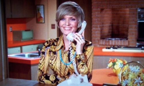Florence Henderson as Carol Brady