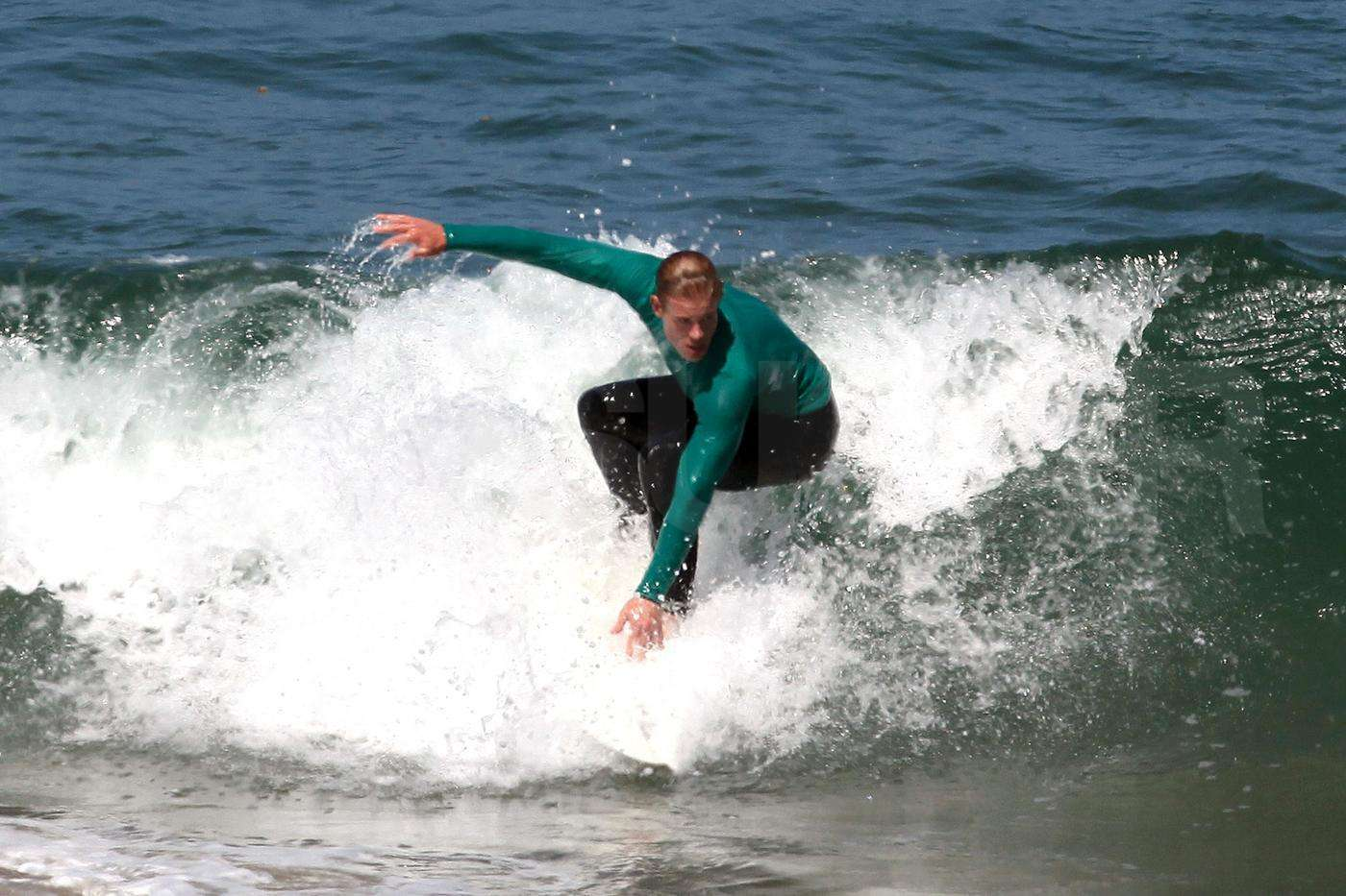 Trevor surfing on set of 90210