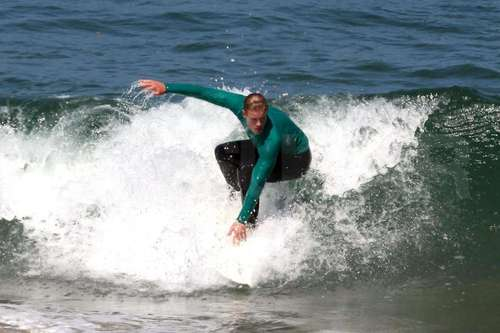 Trevor surfing on set of 90210