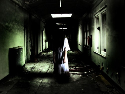 Horror films achtergrond with a penitentiary, a street, and a cell titled Ghost Girl