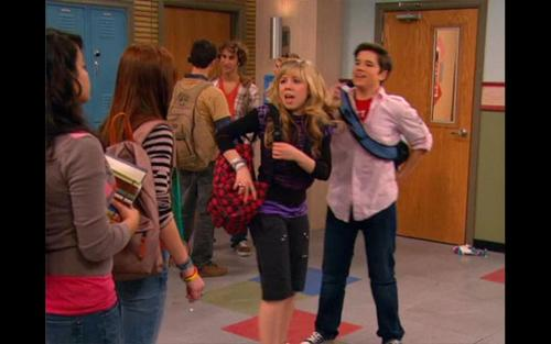 iCarly wolpeyper possibly with a street, a business suit, and a hip boot entitled iTake On Dingo