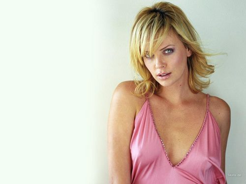 Charlize Theron wallpaper probably with a bustier, a chemise, and a portrait titled Charlize Theron