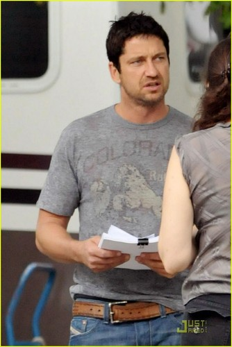 Gerard Butler wallpaper possibly with a sign and a newspaper titled Gerard on the set of 'The Bounty'