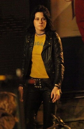 Kristen, wearing a black leaather jacket.
