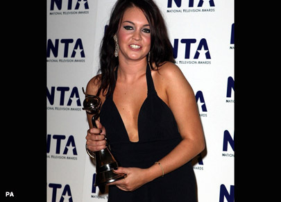 Lacey Turner winning an award