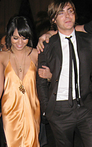 Zac Efron & Vanessa Hudgens wallpaper possibly with a business suit, a well dressed person, and a suit entitled Zac & Vanessa