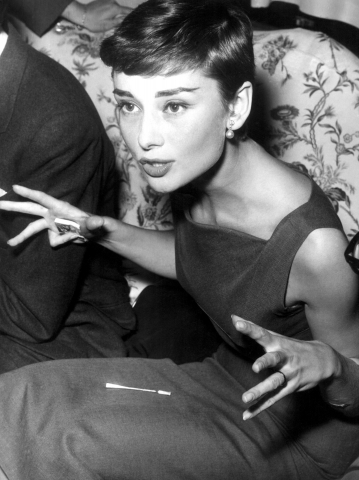 Audrey Hepburn wallpaper probably containing a sign and a neonate entitled Audrey - 1953