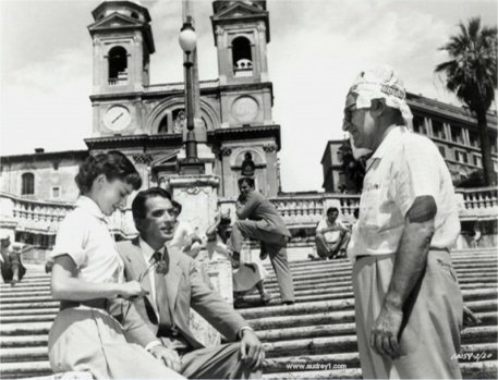 Audrey and Gregory receiving direction on the Spanish Steps