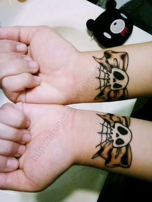 bow tattoos on wrist