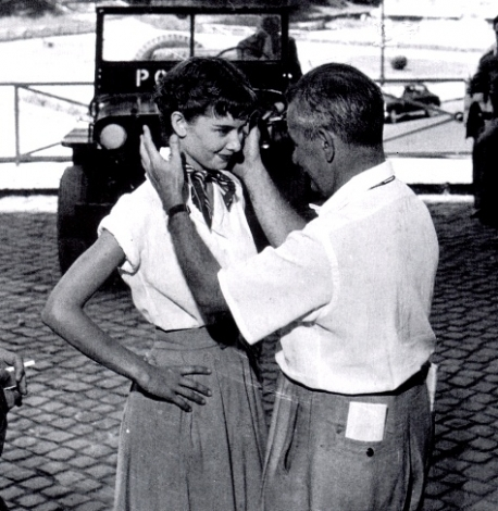 William Wyler giveing Audrey some direction on set in Rome.