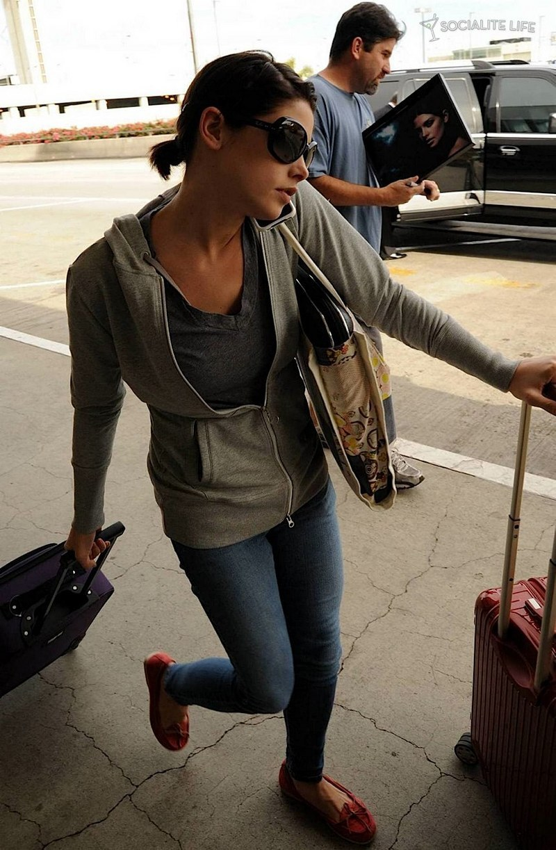 Ashley Greene- at the airport heading to film eclipse