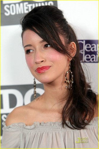 Christian Serratos achtergrond containing a portrait entitled Christian at power of the youth party