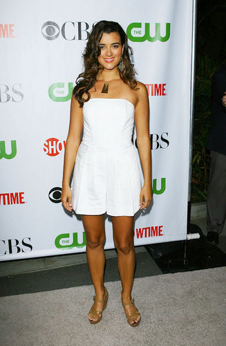 Cote De Pablo kertas dinding probably containing bare legs, a playsuit, and a hip boot called Cote