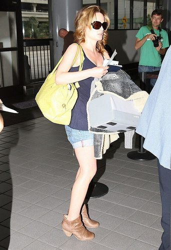 Elizabeth- at the airport heading to eclipse filming