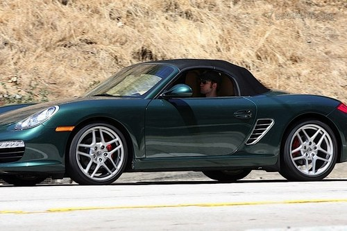 Robert Pattinson is driving away from Kristen Stewart's house (in a Porche)