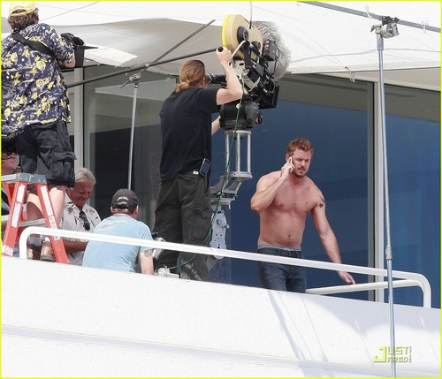 Shirtless Eric Dane on set