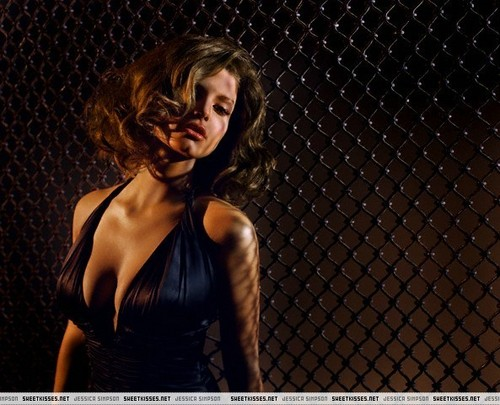 Jessica Simpson wallpaper with a chainlink fence titled Jessica in Maxim