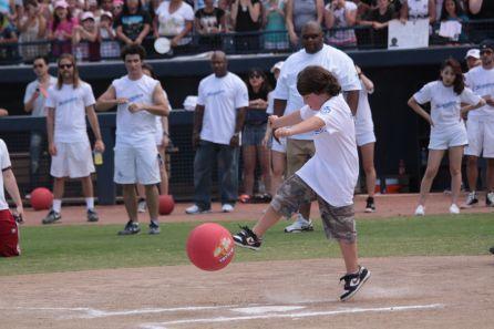Playing kickball.