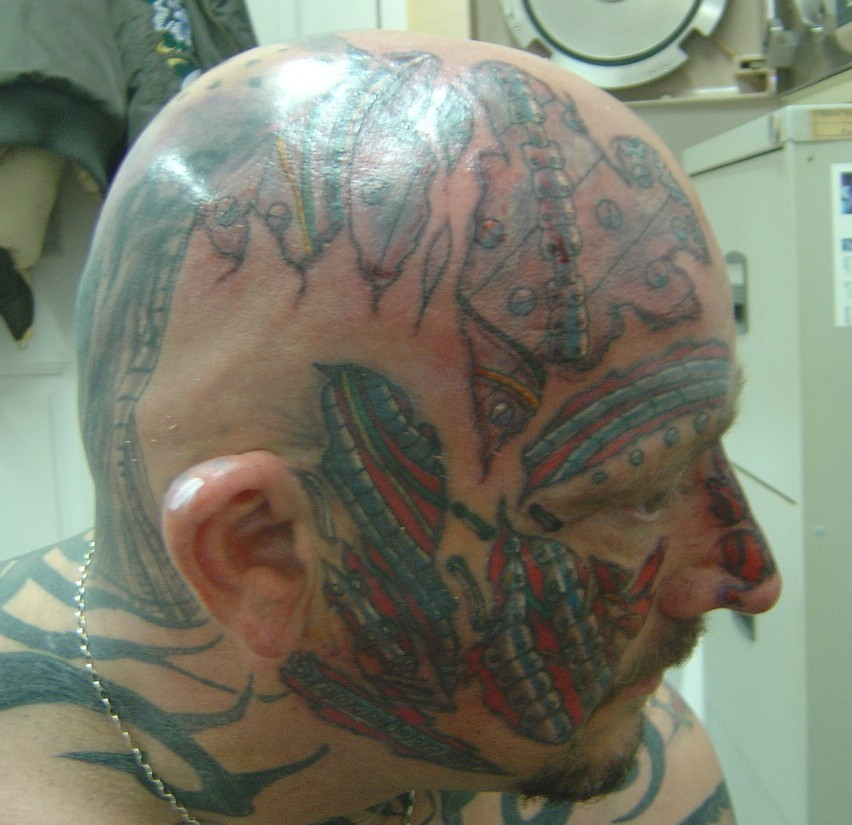 Head and face bio mechanic tattoo