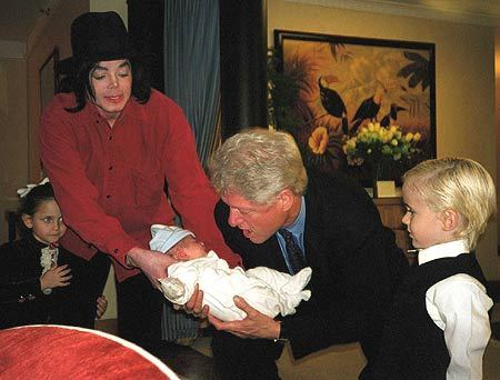 faimly christmas and michael showing bill clinton blanket