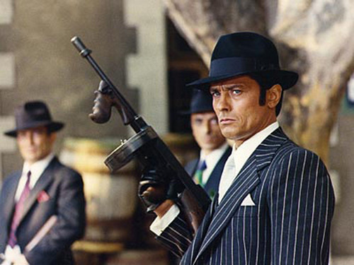 Alain Delon wallpaper probably containing a rifleman, a green beret, and a business suit entitled Borsalino
