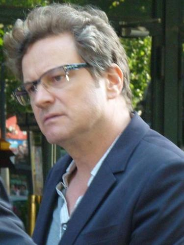 Colin Firth karatasi la kupamba ukuta possibly containing a business suit called Colin Firth in Paris