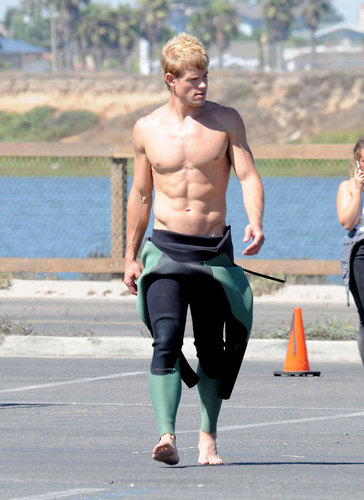Trevor Donovan wallpaper probably containing a hunk titled Hot surfer Trevor on set