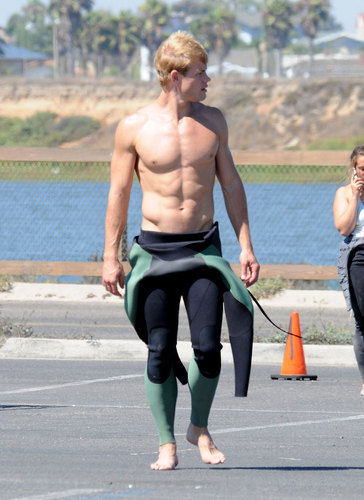 Trevor Donovan wallpaper possibly containing a hunk and a carriageway titled Hot surfer Trevor on set