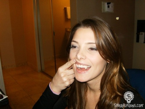 Ashley Greene wearing false vampire fangs